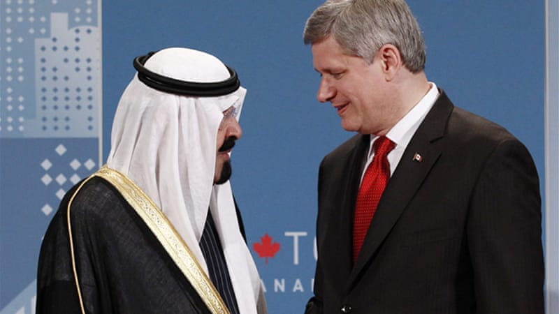 Saudi King Abdullah bin Abdulaziz al-Saud speaks with Canadian Prime Minister Stephen Harper in 2010 [AP]