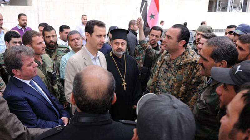 President Assad visited the Christian town of Maaloula, which his forces recaptured last week [Reuters]