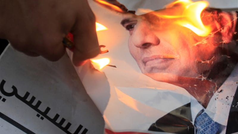 Some demonstrators burned posters of Abdel Fattah el-Sisi, while chanting anti-government slogans [Reuters]