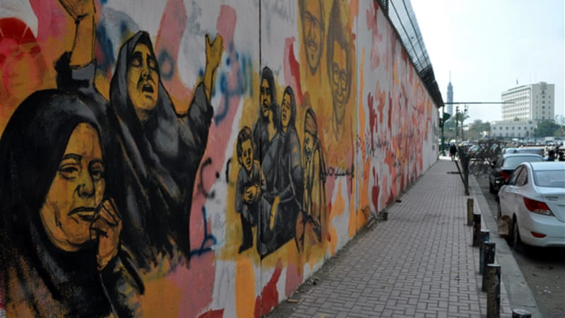 Murals frequently shift and change, with artists defacing or enhancing earlier works [Transterra/Al Jazeera]
