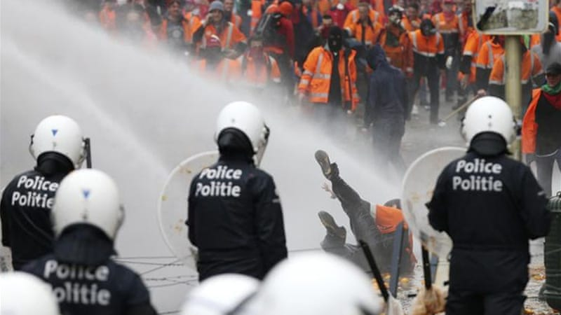 Belgian police used water cannons and pepper spray on the protesters [Reuters]