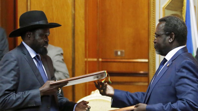 President Salva Kiir and rebel leader Riek Machar signed a new ceasefire agreement on Friday [Reuters]
