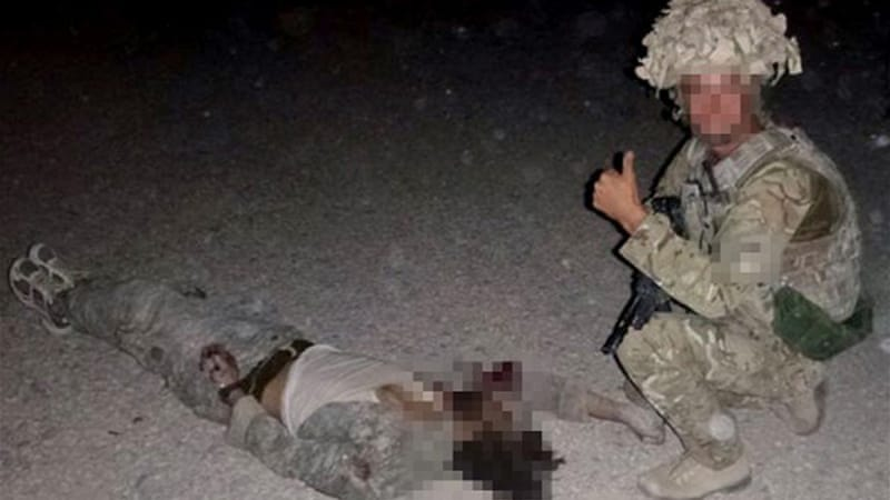 LiveLeak Gallery: UK Probes 'trophy' Pictures Of Dead Taliban
