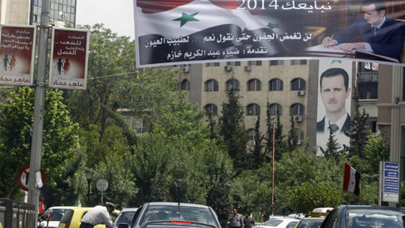 Posters for candidate Maher Abdul-Hafiz Hajjar were hung next to banners of President Assad [Reuters]
