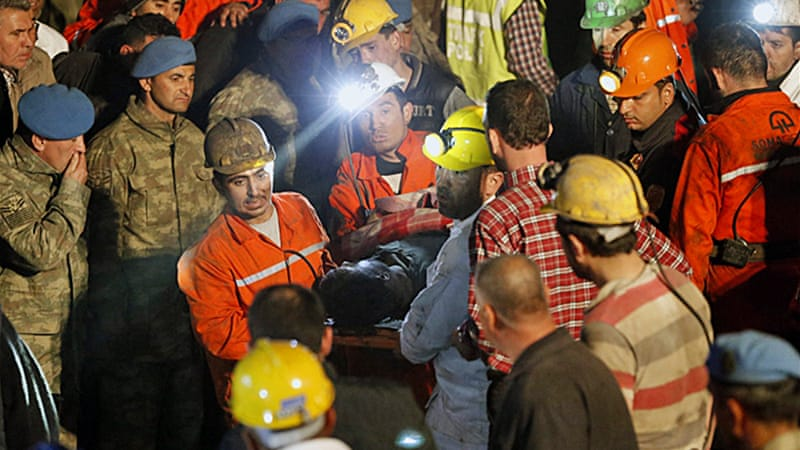 Rescue workers assist victims on Wednesday during a search for miners [AP]