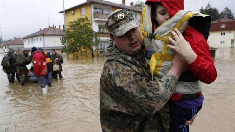 Flooding in Bosnia and Serbia has killed at least 20 people and displaced tens of thousands [EPA]