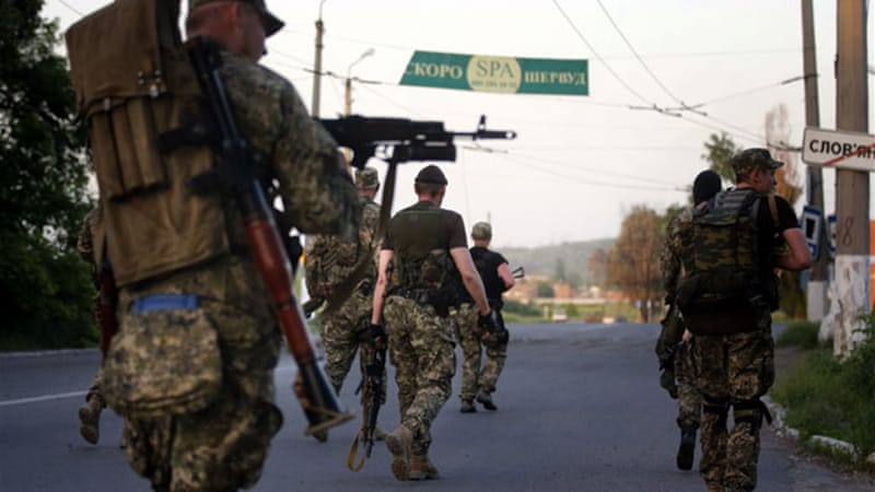 Pro-Russian fighters clashed with Ukrainian soldiers outside Slovyansk, causing an exodus from the area [EPA]
