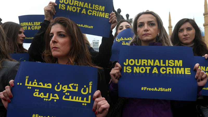 Al Jazeera's journalists stand accused of supporting the outlawed Muslim Brotherhood [AP]