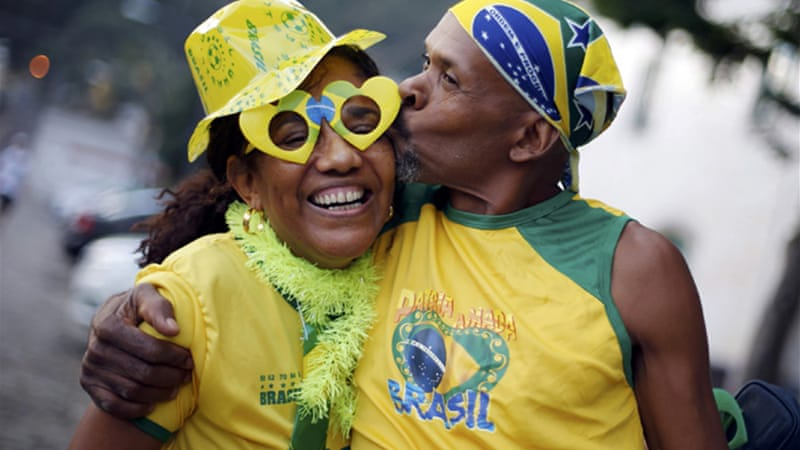 Fans dressed in Brazil's yellow, green and blue home colours cheered the country's 3-1 victory [Reuters]