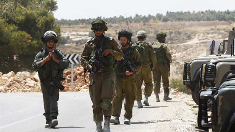 Israeli soldiers scour the countryside around the city of Hebron after the youths vanished [Reuters]