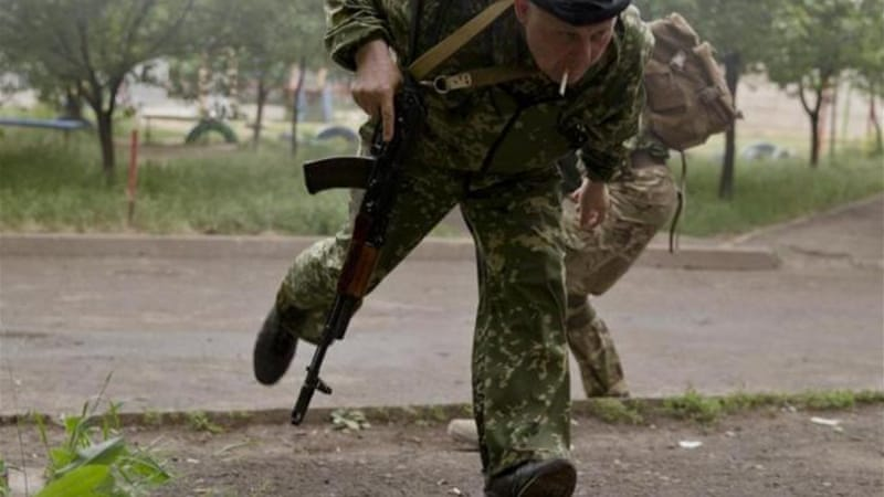 Pro-Russian separatists have mounted bold attacks on government checkpoints in eastern Ukraine [AP]