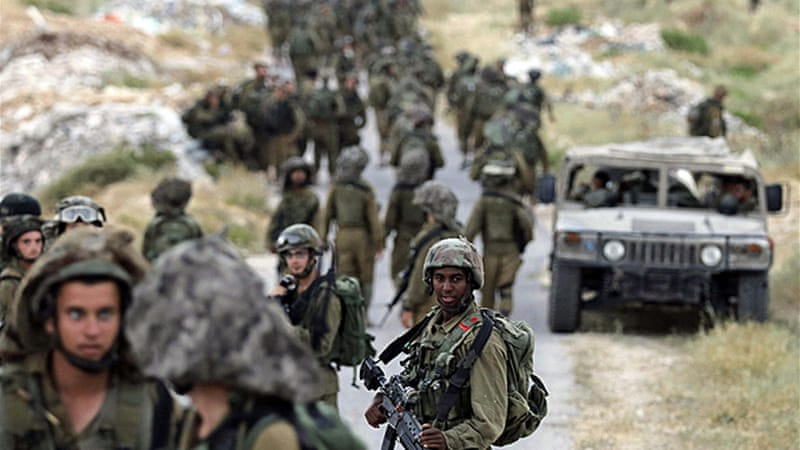 Hundreds of Israeli troops were deployed around the city of Hebron on Saturday [Reuters]