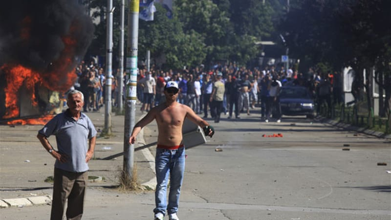 At least 13 police officers and 10 civilians were wounded in the clashes in Mitrovica [Reuters]
