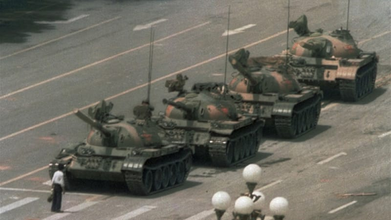 A Chinese man stands alone to block a line of tanks from entering Tiananmen Square on June 4, 1989 [AP]