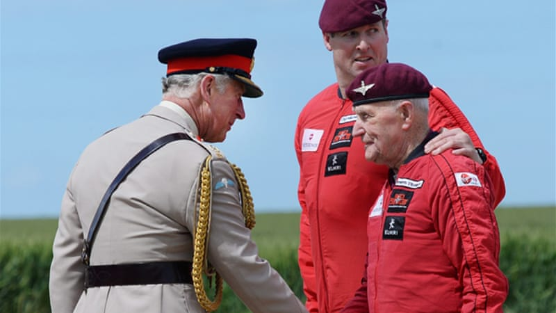 Veteran Jock Hutton, right, on Thursday parachuted to the same spot he landed on as an 19-year-old [EPA]