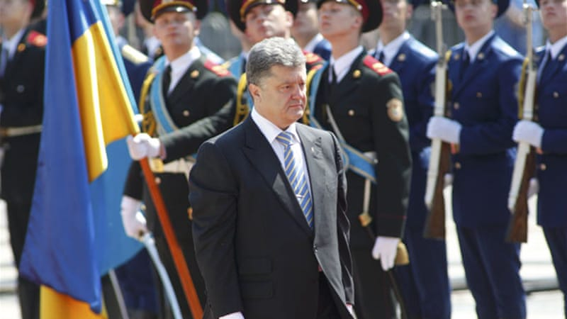 Poroshenko announced the cease-fire on Friday, but warned that the army would hit back if attacked [Reuters]