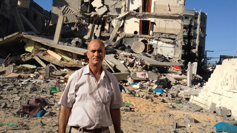 Khader Khader couldn't save anything from his home, not even identification papers [Mohammed Omer/Al Jazeera]
