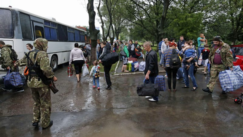 Residents in eastern Ukraine continue to flee to Russia as government forces step up operations against rebels [AP]