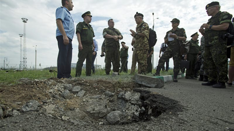 A shell struck a Russian town across the border with eastern Ukraine last Sunday, killing a Russian man [AP]