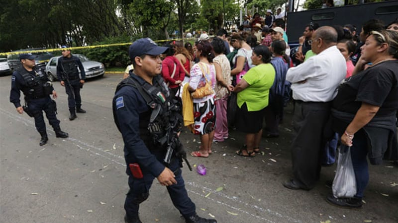 Relatives of the shelter's residents thronged outside the home on Wednesday after the raid [Reuters]