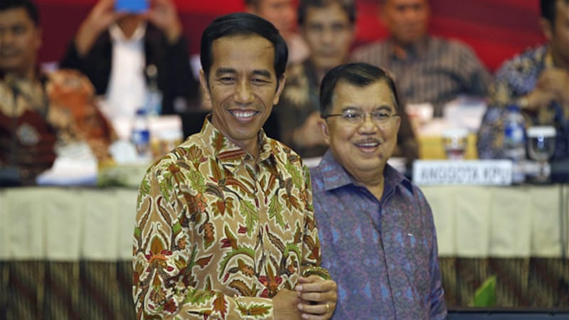 Jokowi and his vice president Jusuf Kalla will take office in October to serve a five-year term [Reuters]