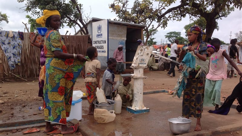 CAR refugees fetch water from a borehole at a camp in eastern Cameroon [Eugene Nforngwa/Al Jazeera]