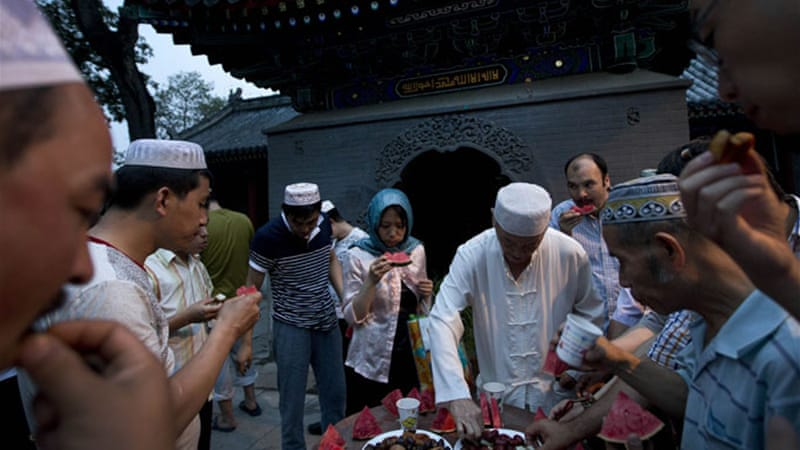 Chinese Muslims gather to break their fast during Ramadan at the Niujie mosque in Beijing [AP]