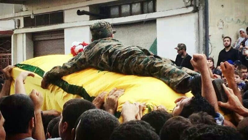 Ibrahim al-Hajj's son clings to his father's coffin. Hajj was killed in a battle near Mosul, sources say [Al Jazeera]