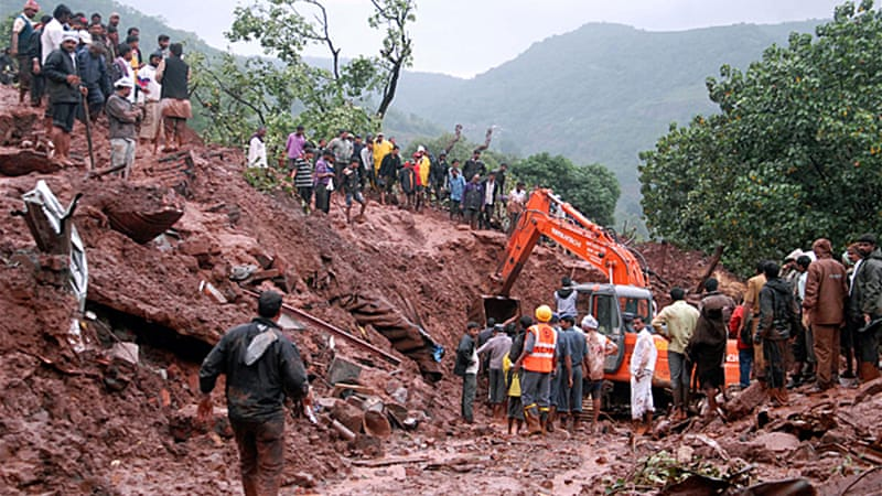People from nearby villages helped rescue workers in removing trees and rocks with their bare hands [AP]
