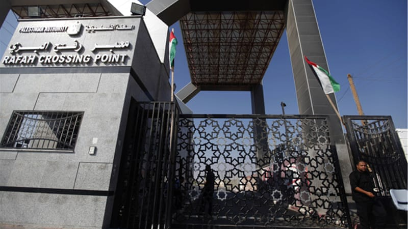 As fighting rages in Gaza, dozens of injured residents have crossed the Rafah border into Egypt [AP]