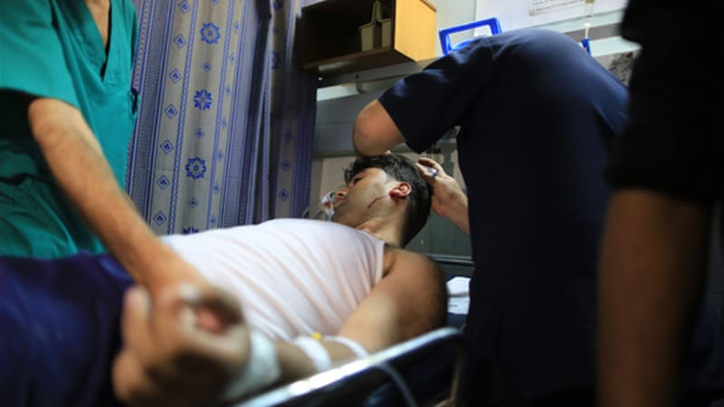 Gaza hospitals struggle to treat wounded