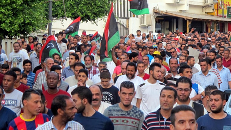 Libyans have protested against the deadly violence in Tripoli and Benghazi [EPA]