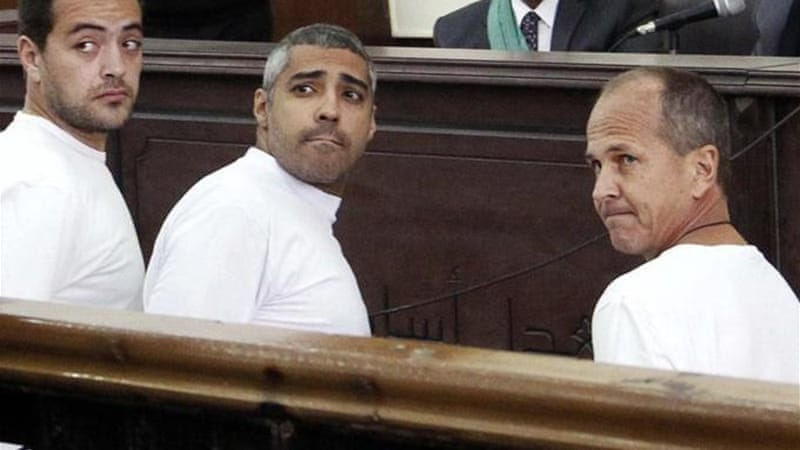 Baher Mohamed, Mohamed Fahmy and Peter Greste were arrested in December [AP]