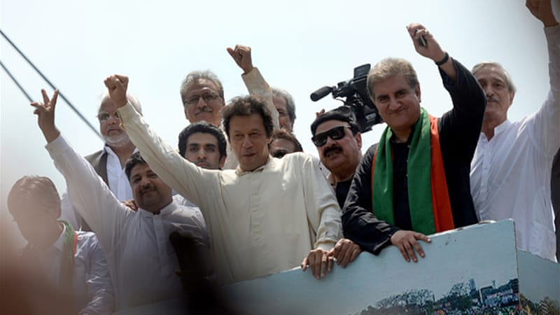 Hundreds of Pakistan Tehreek-e-Insaf (PTI) activists gathered outside Khan's Lahore residence. [AFP]