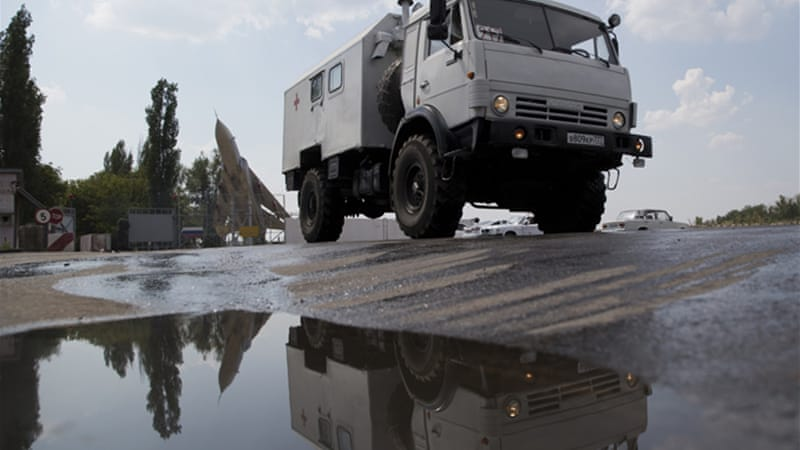 Russia has said the convoy is on the move and heading to the border [AP]