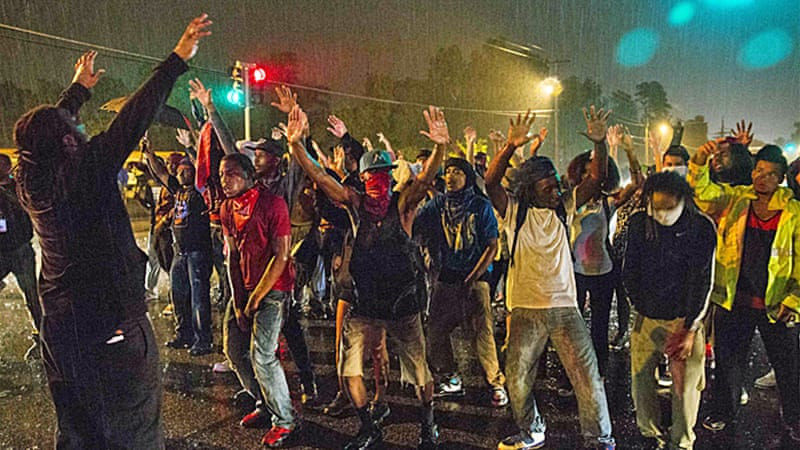 Remaining protesters chanted 'No justice! No curfew!' as the curfew in Ferguson took effect on Sunday [Reuters]