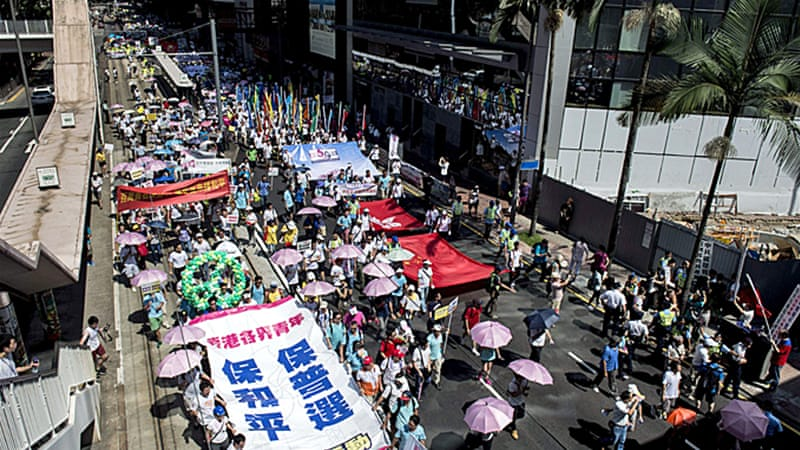 Organisers of Sunday's rally say the silent majority of Hong Kong's residents do not support Occupy [AFP]