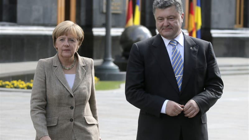 Ukrainian President Petro Poroshenko will hold talks with Russian President Vladimir Putin on Tuesday [AP]
