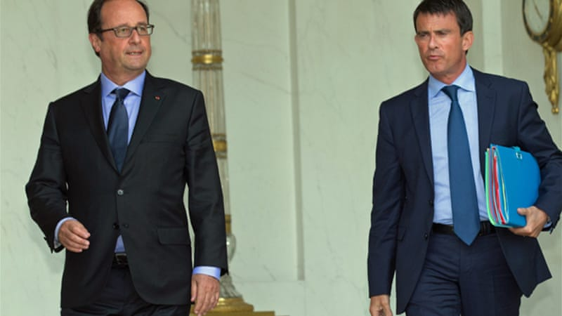The cabinet reshuffle came less than five months after Prime Minister Manuel Valls, right, took office [Reuters]