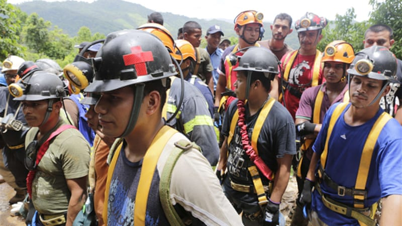 Mining company spokesman Gregorio Downs said teams of dogs had been dispatched to help [AFP]