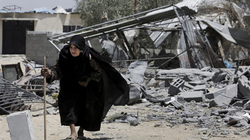 Residents of Gaza are using the truce to return to sift through the rubble of their former homes [AP]
