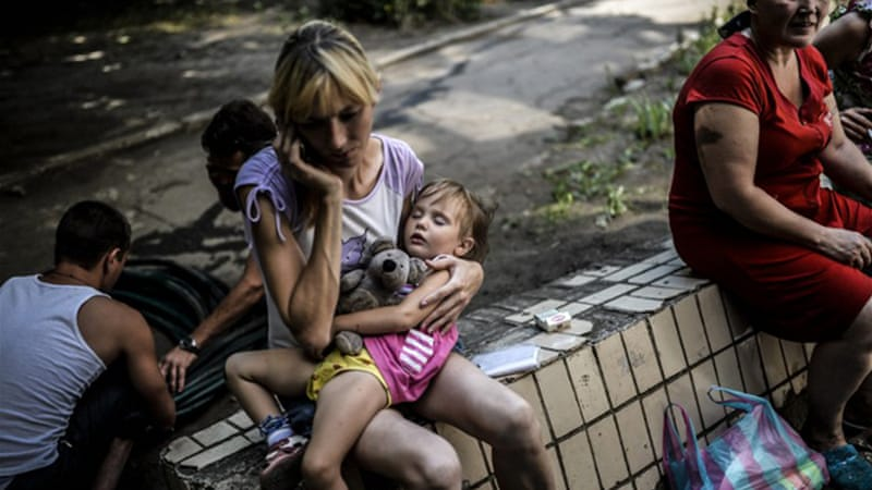 Fighting across eastern Ukraine has forced more than 285,000 people to flee their homes [AFP]