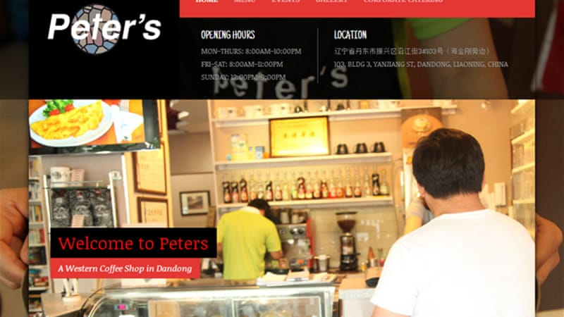 The coffee shop's website says it is beside the Yalu River that divides China and North Korea  [Al Jazeera]