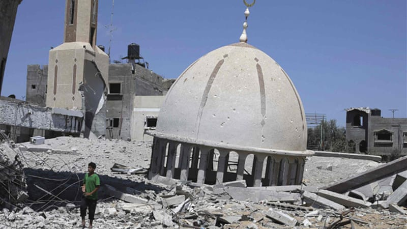 Israeli air strikes destroyed a mosque in Khuza'a, a town of 10,000 residents in the southern Gaza Strip [Reuters]