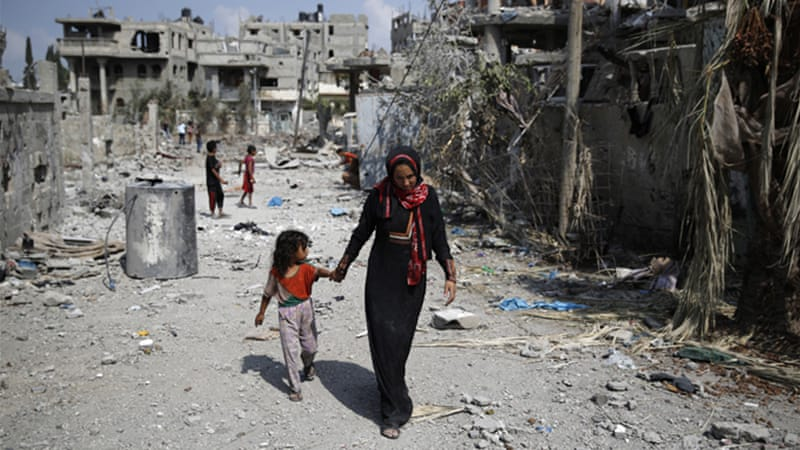At least 30,000 Palestinian homes in Gaza were damaged or destroyed by Israeli shelling and air strikes [Reuters]