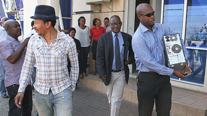 Newspaper editor Outsa Mokone after security agents raided his offices [Victor Baatweng/Al Jazeera]