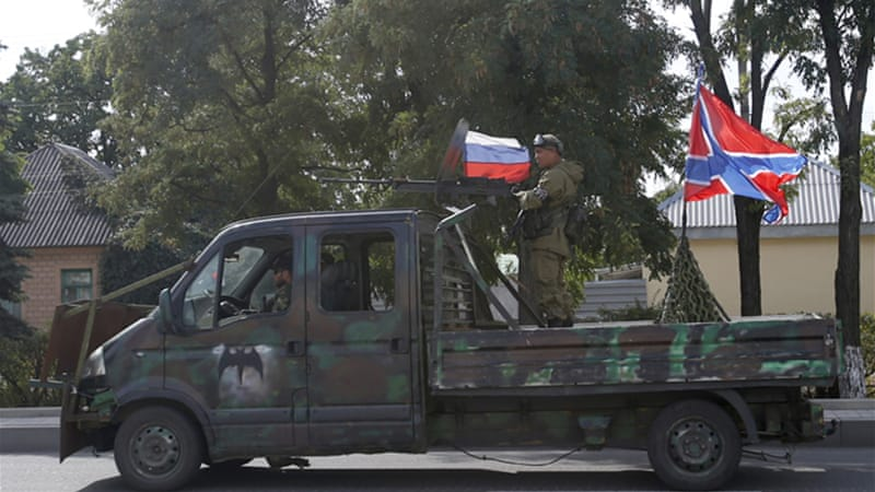 Ukraine and the West accuse Moscow of fuelling the pro-Russian rebellion with troops and weapons [AP]
