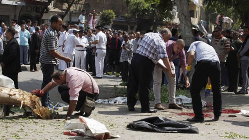 Forensic workers carried out investigations at the scene of the blast near the foreign ministry [Reuters]