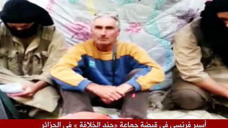 Herve Gourdel was shown sitting between two fighters the video [Al Jazeera]
