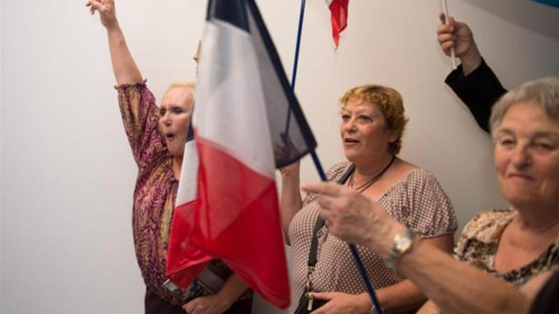 French far right party Front National supporters celebrate win under leader Marine Le Pen [AFP]
